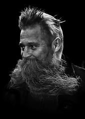 Portrait (D80_547045) (Itzick) Tags: candid copenhagen bw blackbackground bwportrait beard man face facialexpression portrait faces streetphotography denmark d800 itzick