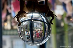 crowds (Little Hand Images) Tags: crystalball upsidedown windowview people blurredbackground diagonalley shop universalorlando florida