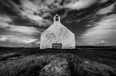 Take a seat or are you staying longer ? (paullangton) Tags: church bw mono blackandwhite sky st cwyfan churchinthesea wales anglesea sea landscape religion faith llangwyfan chapel history coast clouds skancheli