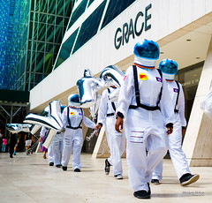 The New Yorkers - NYC space exploration (François Escriva) Tags: street streetphotography us usa nyc ny new york people candid photo rue sun light man colors sidewalk manhattan astronaut helmet blue green fun funny building grace spacesuit space suit balloons