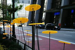 Along Madison Street in Chicago (Cragin Spring) Tags: city chicago chicagoillinois chicagoil illinois il urban unitedstates usa unitedstatesofamerica downtown downtownchicago loop chicagoloop lights yellow discs disc planter madisonstreet chasebuilding street