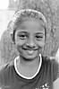 'The most precious thing in this world is a smile on the face of a child.' / Happy  Children's Day! (Ramalakshmi Rajan) Tags: kids nikon nikond5000 nikkor35mm childrensday wishes littlegirls blackandwhite blackwhite