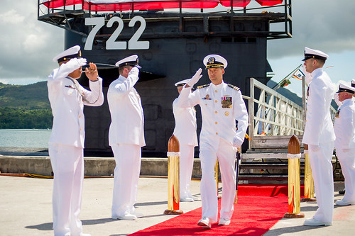 Cmdr. Hill is piped ashore after relinquishing command of Los Angeles-class fast attack submarine USS Key West