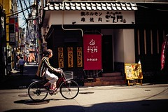 A cyclist wearing striped shirt (snowpine) Tags: street streetphotography streetportrait people portrait cyclist cycling bike bicycle japan kobe candid