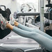 Girl playing weights with legs on the exercise machine