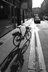 Soho Cycle Shadow (IAmTomJones) Tags: travel life city adventure travelphotography travelbug passion travelmore goexplore newplaces myview photo lifestyle canon photographerlifestyle justgoshoot icatching exploringtheworld optoutside exploretocreate discover discoverearth travelphoto worldpics stayandwander goroam keepexploring travelworld mylifeinphotos photography 2019 2k19 19 travelblogger wanderlust outside street london ldn thelondonproject bw black white blackwhite blackwhitephoto monochrome excellentbnw noir blackwhitelife noirvision contrast blackandwhite streetsofsoho soho bicycle shadow
