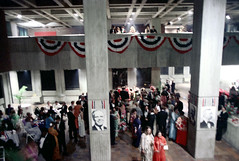 74-270 (ndpa / s. lundeen, archivist) Tags: nick dewolf nickdewolf color photographbynickdewolf 1975 1970s film 35mm 74 reel74 autumn fall boston massachusetts cityhall governmentcenter party gala event people crowd decorations banners men women mayorwhite kevinwhite photo photograph balcony concrete brutalist brutalism architecture interior lobby pillar post patrioticdecorations blurry outoffocus tuxedo tuxedos bowtie blacktie formal