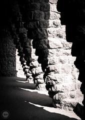 Dopplereffect (dlerps) Tags: amount barcelona catalanya catalunya city daniellerps es espana lerps photography sony sonyalpha sonyalpha99ii sonyalphaa99mark2 sonyalphaa99ii spain spanien urban httplerpsphotography lerpsphotography bw monochrome blackwhite columns parcgüell stones rocks bricks tunnel carlzeiss planar5014za planart1450 shadow shadows sunlight light carlzeissplanar50mmf14ssm