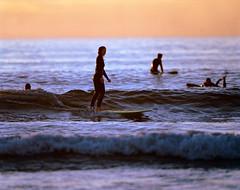 Friday Evening Surfers, Morro Bay, CA (pirate-manners) Tags: morrobay califorina pentax67 ultratelephoto surfers surfing sunset kodak portra portra800