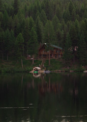 Lake House (CoreyRaff) Tags: landscape nature hiking montana forest mountains trees lake cabin boathouse