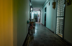 The 2nd floor corridor (Cadicxv8) Tags: street streetphotography apartment bicycle saigon night