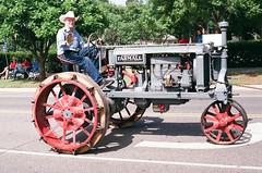 Stylish even when towed (radargeek) Tags: film 35mm 2019 parade oklahoma minolta x370s edmond libertyfest july 4thofjuly tractor farmall