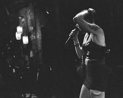 Kate bringing the tunes (radargeek) Tags: film 35mm 2019 oklahoma bw iso3200 minolta x370s pistolbridge thepanoramamusichouse lakecharles louisiana la singing
