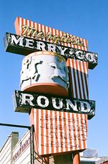 Merry Go Round (radargeek) Tags: film 35mm 2019 lonepine ca california minolta x370s neon neons sign signage