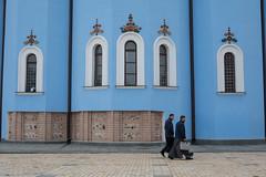 Colourful Kyiv (Geraint Rowland Photography) Tags: streetphotography candid men religion stmichaelsgoldendomedmonastery church kiev kyiv blue bluechurch ukraine easterneurope houseofgod god catholic christianity windows symmetry 50mm