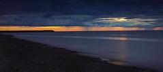 Blue rain - Pluie bleue (olivier_kassel) Tags: canada québec quebec fleuvesaintlaurent saintlawrenceriver crépuscule dusk sunset coucherdesoleil fleuve river ciel sky nuages clouds rain pluie matane
