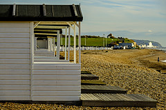 Beach huts towards Hastings (ianbartlett) Tags: outdoor 365 landscapes seascapes water fishermen boats sea people windows trains birds wildlife nature rocks cliffs buildings huts reflections sunsets