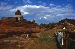 Mrauk U, Htukkant Thein temple and Shite-thaung temple (blauepics) Tags: myanmar birma burma southeast asia südostasien 1996 myauk mrauk u mrauku rakhine arakan state province provinz burmese birmanen arakanese htukkant thein htukkanthein shitethaung shaitthaung shitthaung temple buddhism buddhismus king könig min phalaung bin religion stupa bell glocke hill hügel clouds wolken history geschichte landscape landschaft rural ländlich perspective perspektive poverty armut well brunnen water wasser