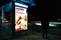 (Yutaka Seki) Tags: minoltamaxxum4 cameratest fujicolorc200 homedeveloped unicolorpresskit pakonf135 nightphotography filmatnight lighttrail car automobile busstop waiting pedestrian streetphotography sign illuminated nutella hazelnuts timhortons coffee croissant cookies pancakes