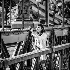Selfie on the bridge (John Riper) Tags: johnriper street photography straatfotografie square vierkant bw black white zwartwit mono monochrome hungary budapest candid john riper fujifilm fuji xt1 18135 bridge woman selfie stick szabadság híd