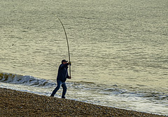 Beach fishing action (ianbartlett) Tags: outdoor 365 landscapes seascapes water fishermen boats sea people windows trains birds wildlife nature rocks cliffs buildings huts reflections sunsets