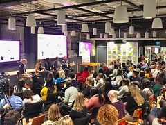 """Packed room and hallway at Social Media Week Toronto @smwitoronto Talk about with non profits about """"Big Impact, Small Budget: Do More with Less"""" featuring Children's Wish Foundation, Oceana, George Brown College, Pathways to Education & SKETCH. #smwto #r"""