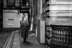 Passage (Leanne Boulton) Tags: urban street candid streetphotography portrait candidstreetphotography streetportrait candidportrait streetlife sociallandscape filmnoir cinematic old man male face expression mood atmosphere emotion feeling alley alleyway sunlight movie shadow tone texture detail depth naturallight outdoor light shade city scene human life living humanity society culture lifestyle people canon canon5dmkiii 70mm ef2470mmf28liiusm black white blackwhite bw mono blackandwhite monochrome noir glasgow scotland uk