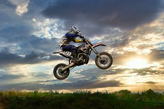 Taking Off (joseph_donnelly) Tags: luminar4 luminar takeoff jumping jump sport clouds sun sky biker bike moto motocross