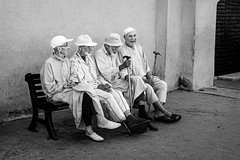 Friends of Marrakech (amarilloladi) Tags: friendship marrakech morocco africa bench streetphotography friends elderly retirement relaxation rest break leisure hats robes blackandwhite bw blackandwhitephotography monochrome