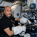 ESA (European Space Agency) astronaut Luca Parmitano tests the usage of specialized spacewalking tools