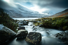 Dark Skies (Nathan J Hammonds) Tags: wales snowdonia ogwen valley glyders tryfan uk stream bridge clouds sun snow winter water long exposure nd filters 10stop moody dark skies rocks