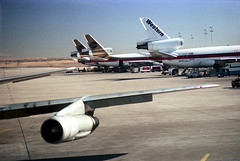 74-285 (ndpa / s. lundeen, archivist) Tags: nick dewolf nickdewolf color photographbynickdewolf 1975 1970s film 35mm 74 reel74 autumn fall denver colorado stapleton airport stapletoninternationalairport den tarmac plane airplane planes airplanes aircraft western westernairlines vehicles supportvehicles jet jets wing airplanewing engine jetengine sky bluesky continental continentalairlines dc10