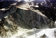 74-282 (ndpa / s. lundeen, archivist) Tags: nick dewolf nickdewolf color photographbynickdewolf 1975 1970s film 35mm 74 reel74 autumn fall colorado fromtheairplanewindow aerial mountains landscape rockies rockymountains peaks snow snowcovered