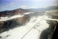 74-278 (ndpa / s. lundeen, archivist) Tags: nick dewolf nickdewolf color photographbynickdewolf 1975 1970s film 35mm 74 reel74 autumn fall colorado fromtheairplanewindow aerial mountains landscape rockies rockymountains sky bluesky valley snow roaringforkvalley aspenmountain redbutte highway82 route82 82 road highway wing airplanewing