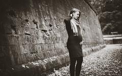 Not long anymore ... (HeiJoWa) Tags: sony a6000 alpha 6000 sel50f18 portrait porträt woman baby belly bw sw blackwhite schwarzweiss monochrome herrnergal mauer wall bokeh unscharf blurry stimmung melancholy melancholie kleid dress