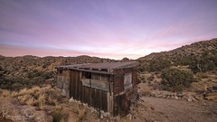 Mojave Morning (magnetic_red) Tags: sunrise sky pink clouds morning landscape building shack ruin abandoned desert mountains americanwest mojavenationalpreserve