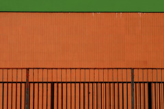 composition - 135 (Rino Alessandrini) Tags: architecture pattern backgrounds builtstructure buildingexterior nopeople yellow outdoors abstract textured wallbuildingfeature closeup urbanscene material metal orangecolor everypixel red concrete brick symbol design cement flag sign constructionindustry flooring white industry cargocontainer warehouse steel minimalist lines shapes geometries contrasts oblique