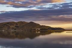 Lake Titicaca Puno (twohamstersca) Tags: landscape puno lake titicaca peru sky sunrise nature canon mountain village reflection