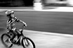 So Fast! (Masa Kuwajima) Tags: bicycle bike boy kid child ride motion speed street sport bw blackandwhite canona1 kodaktmax400 epsonv700