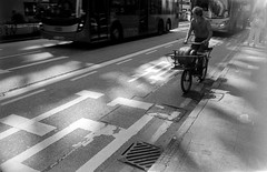 Light leaks... (David Davidoff) Tags: people street bike bicycle deliveryman gasdelivery cityscene urbanprospects kentmere400 blackwhitefilm akarexiii xenagon35mmf35 rangefindercamera mechanical moment monochrome analogue shadow light