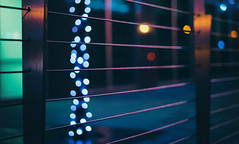 Urban fence... (Sarah Rausch) Tags: bokeh hff fencefriday nashville lights fence city night sony 50mm 18 urban