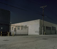 (ADMurr) Tags: la eastside night industrial open gate warehouse gray buff black sky hasselblad 500cm 50mm distagon zeiss fuji pro 400 film 6x7 crop dba670