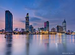 Buổi chiều đẹp (Huỳnh Tấn Phát) Tags: vietnam downtown saigon river building sky clouds reflection sunset skyline tower cityscape landscape colorful nice olympus panasonic 714mmf4 em1 mark ii omd simple