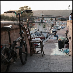 La bicicletta del pescatore_Tele Rolleiflex (ksadjina) Tags: bosa italia lasardegna pescatore carlzeisssonnar135mmf4 film scan silverfast nikonsupercoolscan9000ed c41 6x6 analog kodakportra160