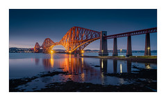 Lady in Red (Dave Fieldhouse Photography) Tags: bridge water night reflections lights scotland edinburgh illumination bluehour firthofforth queensferry forthrailbridge fuji railway structure fujifilm lowtide urbanlandscape fujixt2 wwwdavefieldhousephotographycom