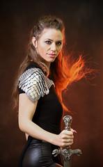 Fierce swordmaiden (Princess Ruto) Tags: sword warrior cosplay leather model fire armor steel brunette redhead