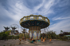 Carousel in an Abandoned Theme Park in China (Explored #7) (rantropolis) Tags: abandoned theme park china abandonedpark carousel chairs oriental sino wonderland