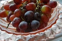 pink glass with grapes (quietpurplehaze07) Tags: lookingcloseonfriday glass dish pinkglass grapes fruit cristal