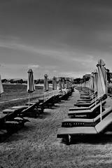beach (Love me tender ♪¸.•*´¨´¨*•.♪¸.•*´) Tags: beach sand umbrella beachbeds sky se seascape shadow prospective landscape alimos greece dimitrakirgiannaki nikon photography blackandwhite sunset urban city architecture