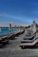 beach (Love me tender ♪¸.•*´¨´¨*•.♪¸.•*´) Tags: beach sand umbrella beachbeds sky se seascape shadow prospective landscape alimos greece dimitrakirgiannaki nikon photography blue sunset urban city architecture